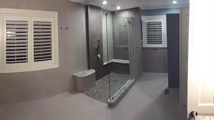 curbless shower with 12x48 porclainosa tile