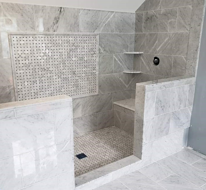 marble shower with inset and 2 benches