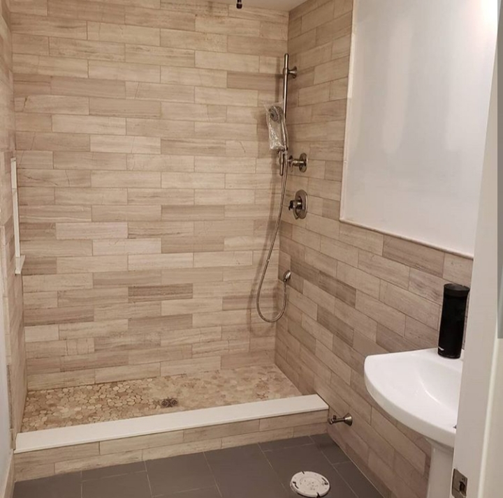 natural stone shower with pebble floor