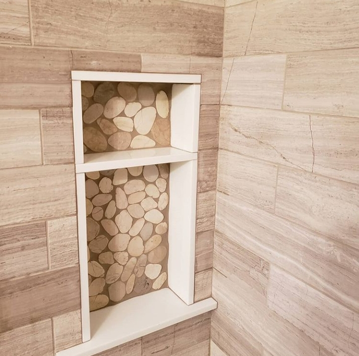 natural stone shower with pebble niche