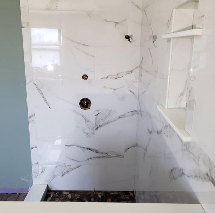porcelain tile shower with niche